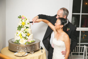 Bride and Groom Cut Floral Wedding Cake